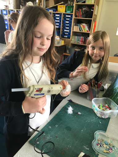 The children who are 8 are able to use the glue gun, otherwise they are supervised!  This is a great opportunity for the children to work with this type of equipment!