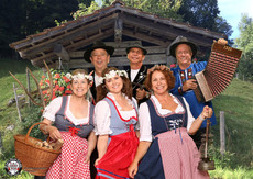 Swiss costumes, propes and big smiles at Heidi's Photo Chalet