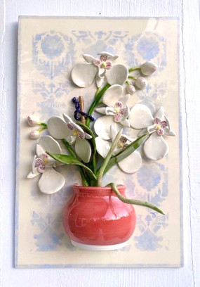 Orchid in little Red Jug