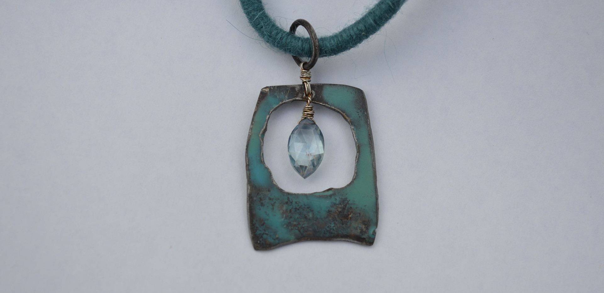 Encaustic on Steel & Aqua Marine on felted wool cord necklace