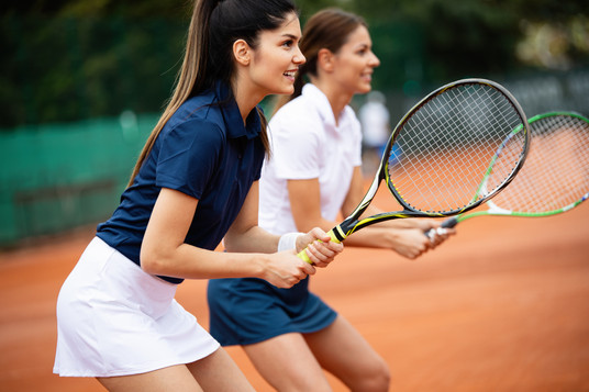 young-happy-women-friends-playing-tennis