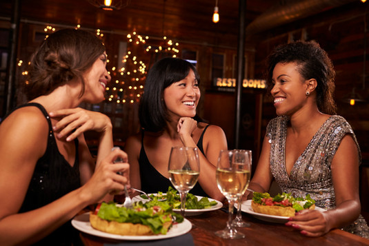 three-female-friends-eating-dinner-toget