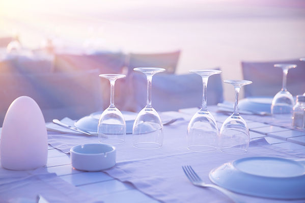 A dinner table overlooking the ocean