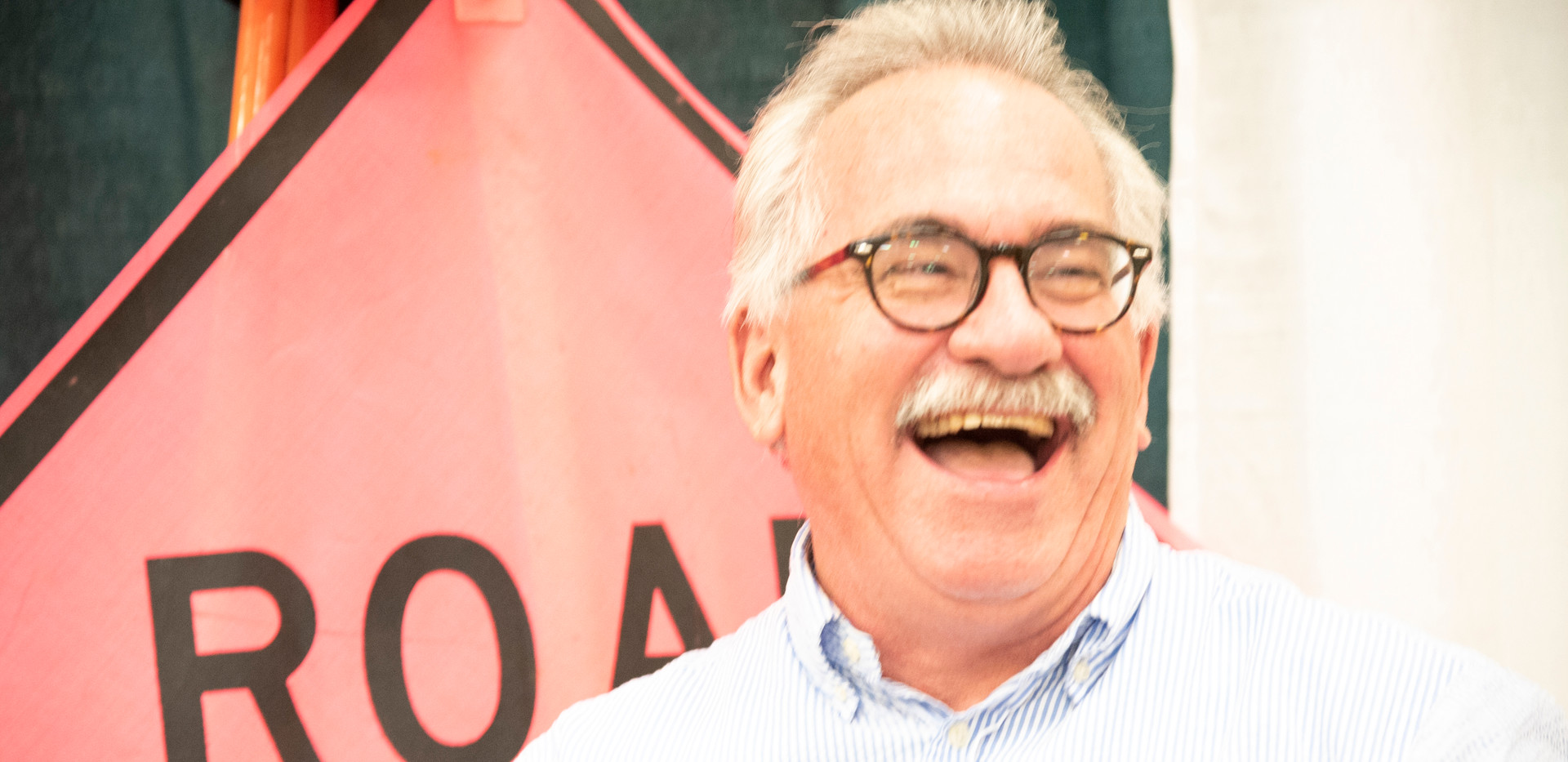 man laughing tradeshow.jpg