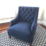 Isn't this deep buttoned navy armchair j