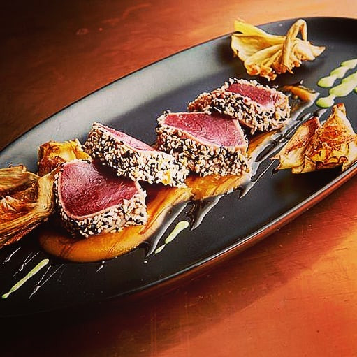 Seared ahi, black & white sesame, spicy peanut sauce.  #simplefood #delish #smallplates #restaurantappetizer #kitchencoaching