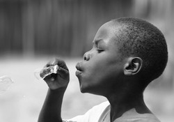 African Boy Blowing Bubbles