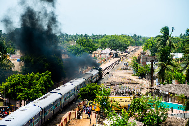 A Train blows off steam after crossing t