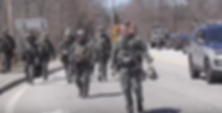militarized police on street.png