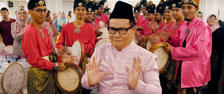 Not My Mother's Baking Movie Still - Mr Tan performs the 'silat'