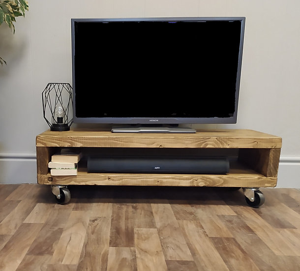 600 : Low Tv stand with cast iron swivel wheels / coffee table