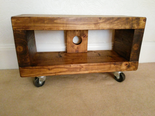 590: Tv stand chunky wood with cast iron industrial swivel wheels
