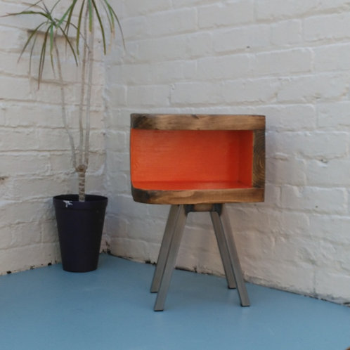 339: Side table with curved front and steel legs. Bunker style painted interior