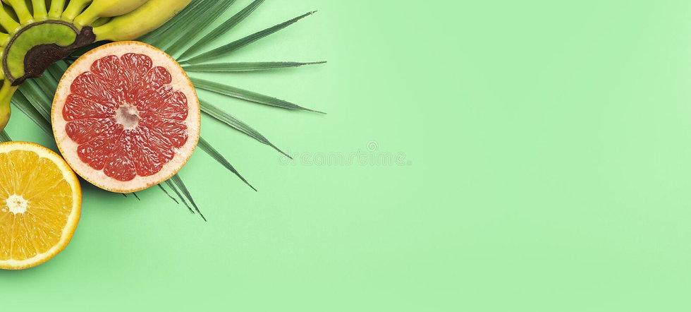 fondo-de-banner-verano-frutas-tropicales-naranjas-y-toronjas-bananas-en-un-verde-color-sua