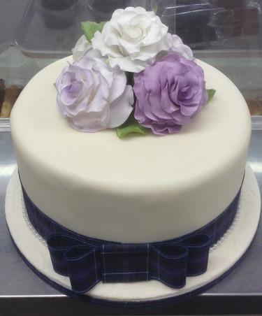 PURPLE AND TARTAN WEDDING CAKE