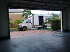 truck with hoses going into house.jpg