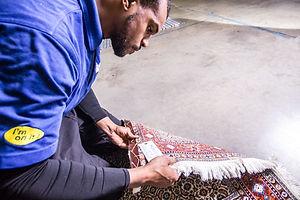 Technician inspecting wool area rug