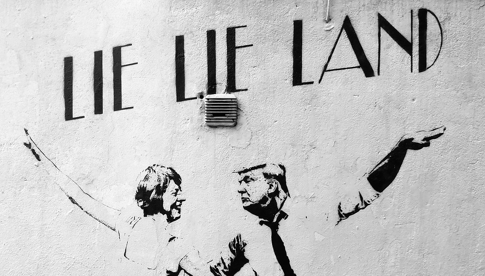 """Lie Lie Land"" by street artist Bambi spoofs the Hollywood movie with May and Trump as the dancers, Islington, London"