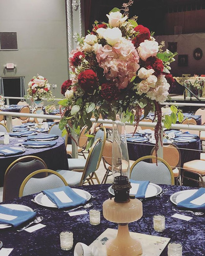 Each of the tall centerpieces adorned an