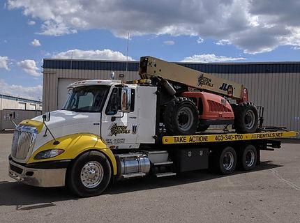 equipment transport truck roll off deck