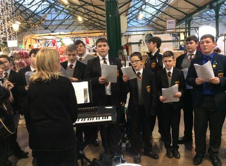 De La Salle choir sing at St George's Market