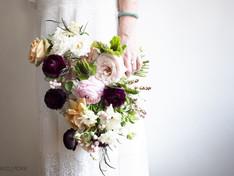Bridesmaid holding floral bouquet