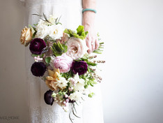 Bridesmaid holding floral bouquet