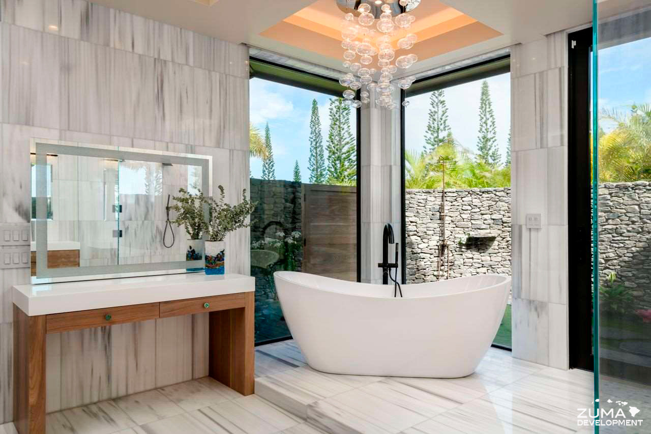 Master Bath has an elevated freestanding tub with a view of the shower garden