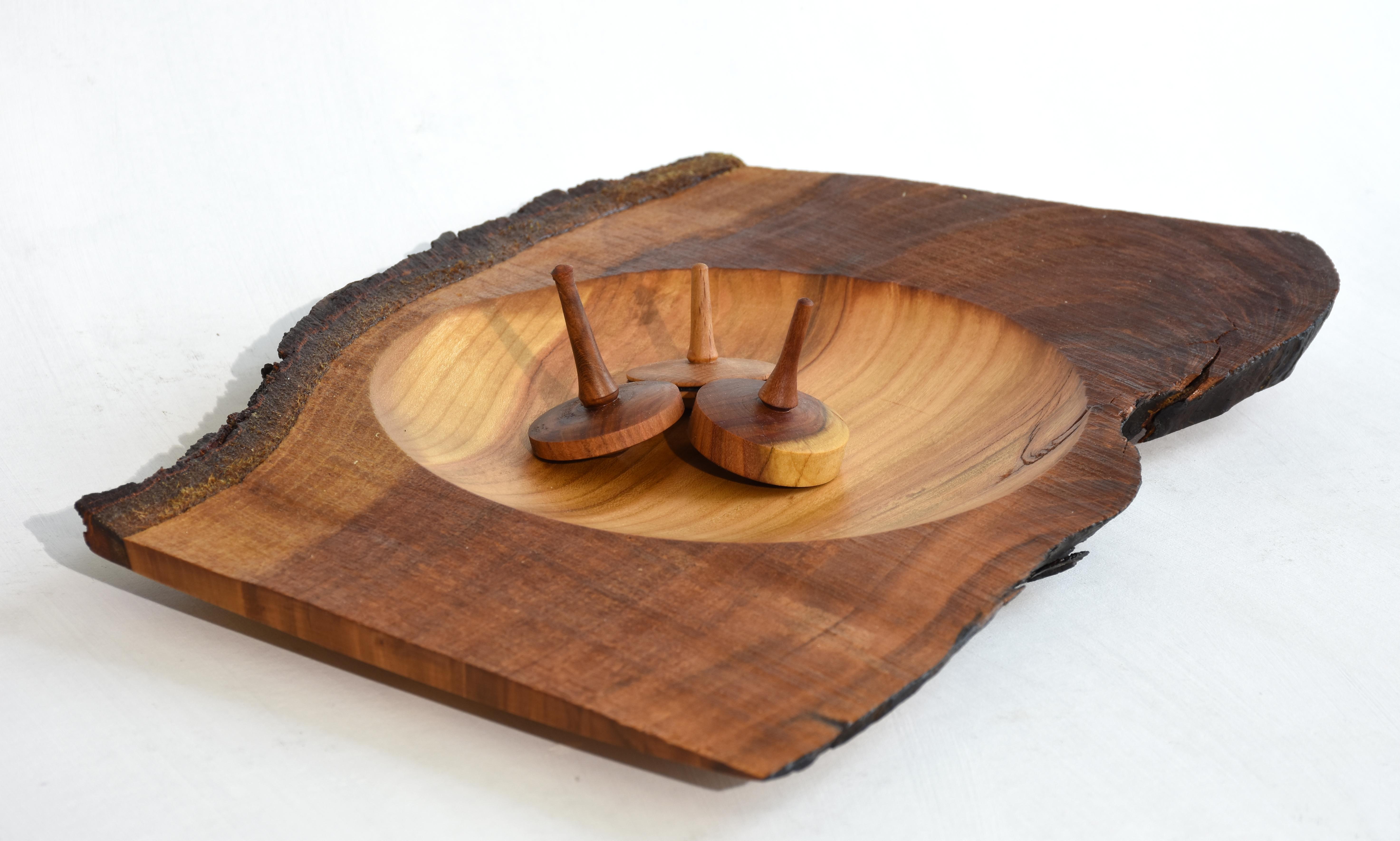 Pfirsichholz mit drei Kreiseln