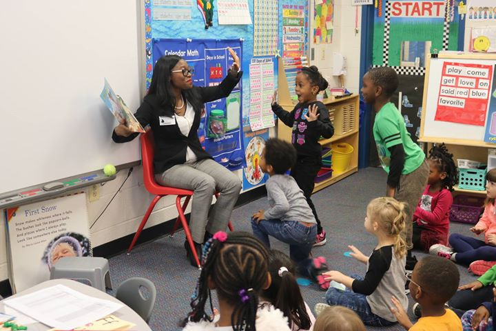 Abena reading at read across american day.