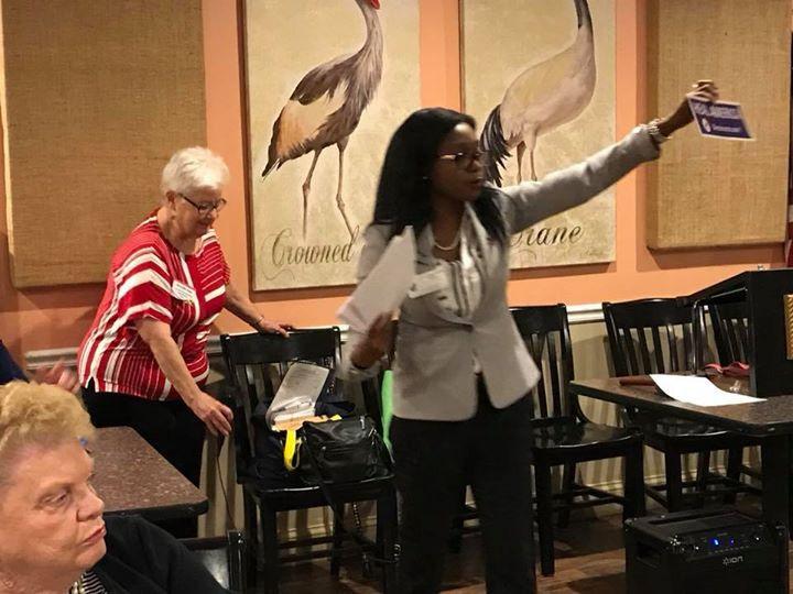 Abena updating the Democratic club on new party initatives.