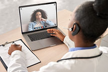 African doctor wear headset consult fema