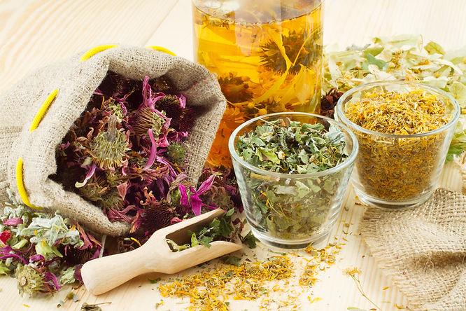 healthy tea, healing herbs on wooden tab