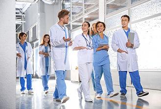 Medical Students Walking in Corridor - A