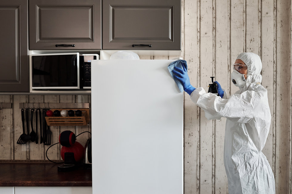 person-in-protective-suit-disinfecting-a