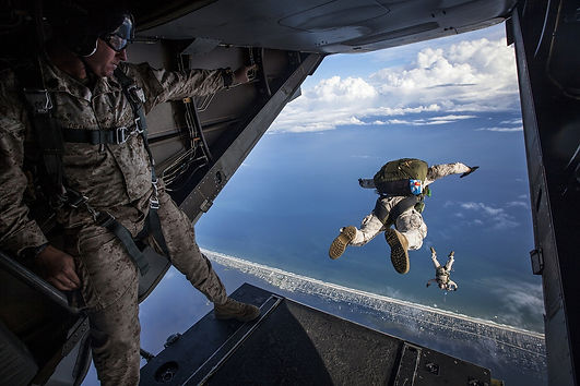 paratrooper jumping out of a plain