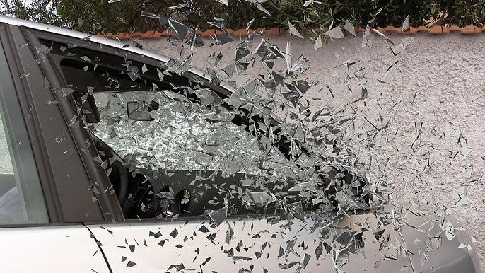 shattered glass from broken car window flying everywhereere