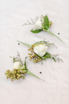 Ranunculus boutonnières  Photo by Amy Hutchinson Photography