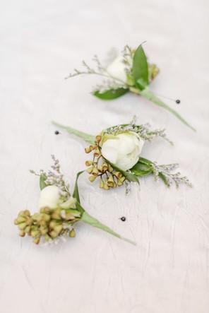 Ranunculus boutonnières  Photo by Amy Hutchinson Photography