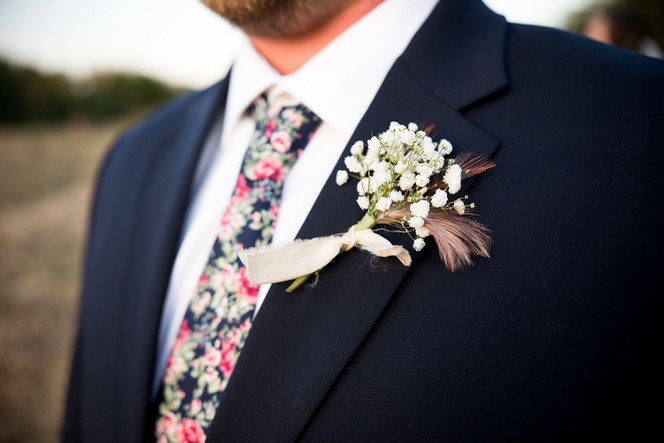 Groom's boutonnière with duck feathers.  Photo by Morgan Newsom Photography