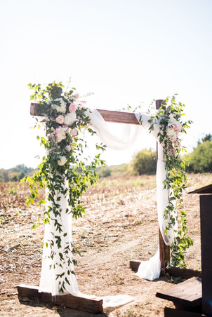 Outdoor ceremony with a gorgeous arbor  Photo by Morgan Newsom Photography