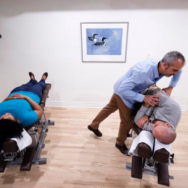 Adjusting at AVANT Chiropractic
