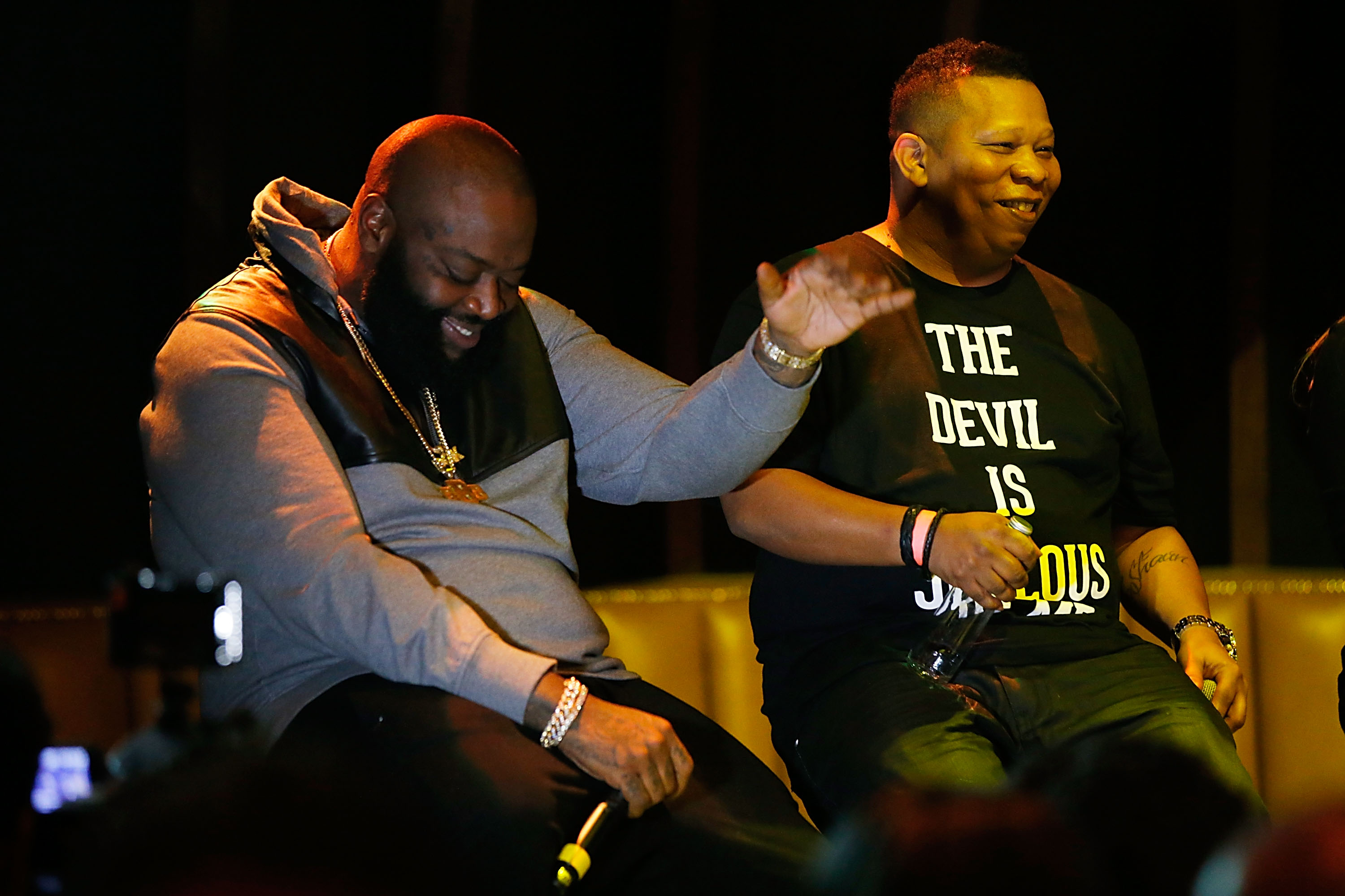 Rick Ross laughs while on panel