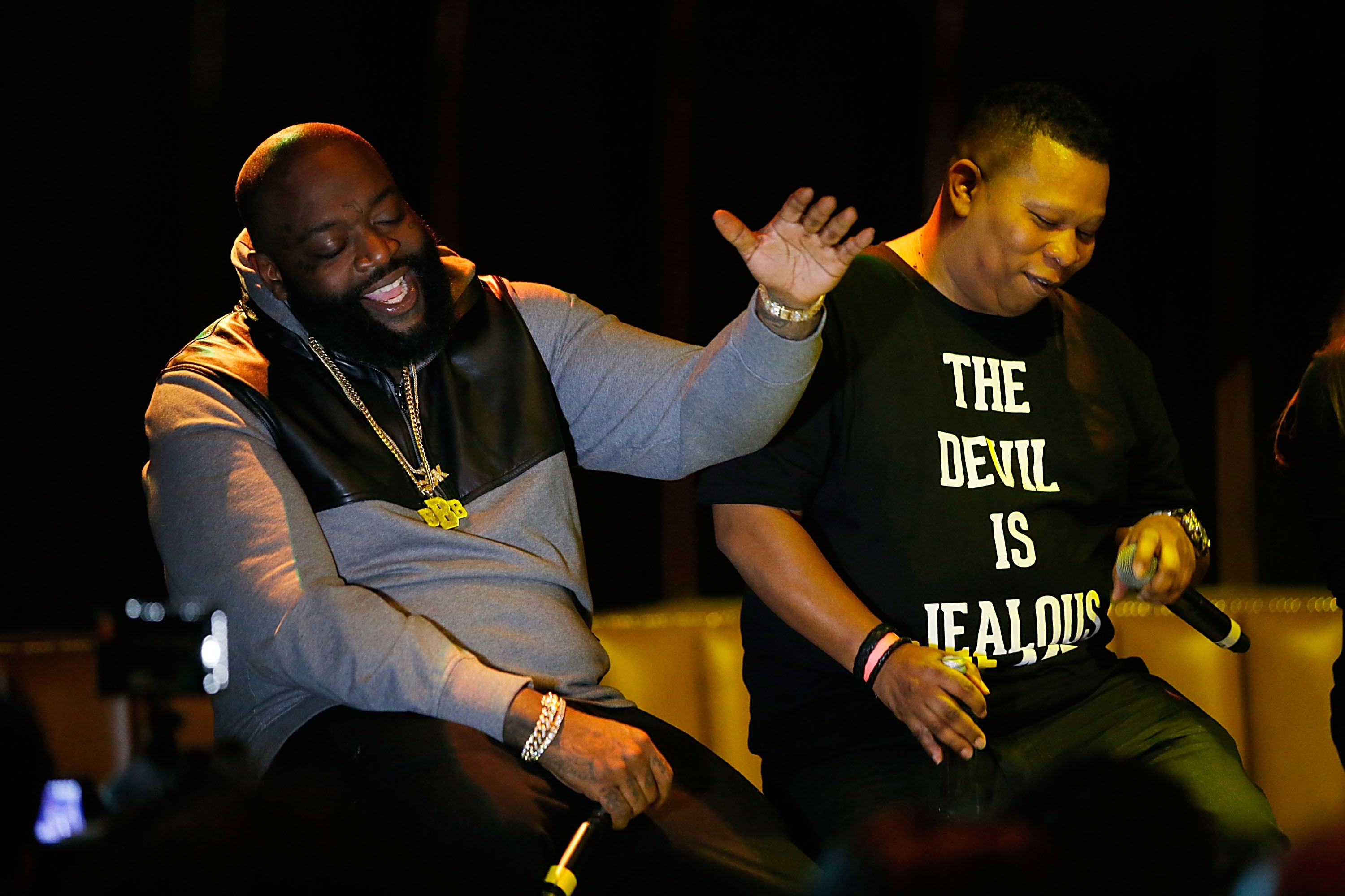 Rick Ross laughs at questions