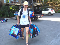 Bringing therapeutic art & learning supplies, & basic living supplies by Adriana to children in need