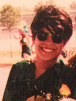 Rhea at her High School graduation with wig on due to her cancer