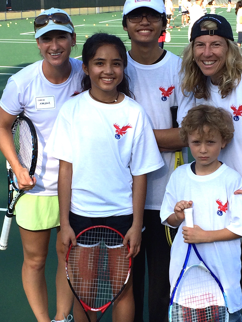 Adriana & AJ Eglin Air Force Base teaching US military children tennis.