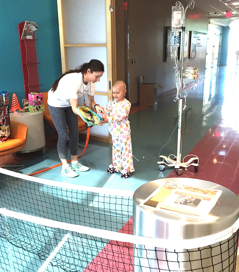 Little Star. Adriana teaching tennis during LSF Hosp Program
