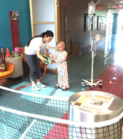 Little Star. Adriana teaching tennis during LSF Hosp Program