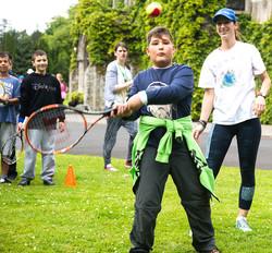 Helping teach tennis to kids with diseases program